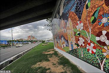 ترسیم نقاشی دیواری شهید لشگری و برادران شهید اسداللهی