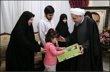 Rouhani visits family of martyred nuclear scientist