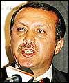 أردوغان: منع الحجاب أشعل الحريق الفرنسي